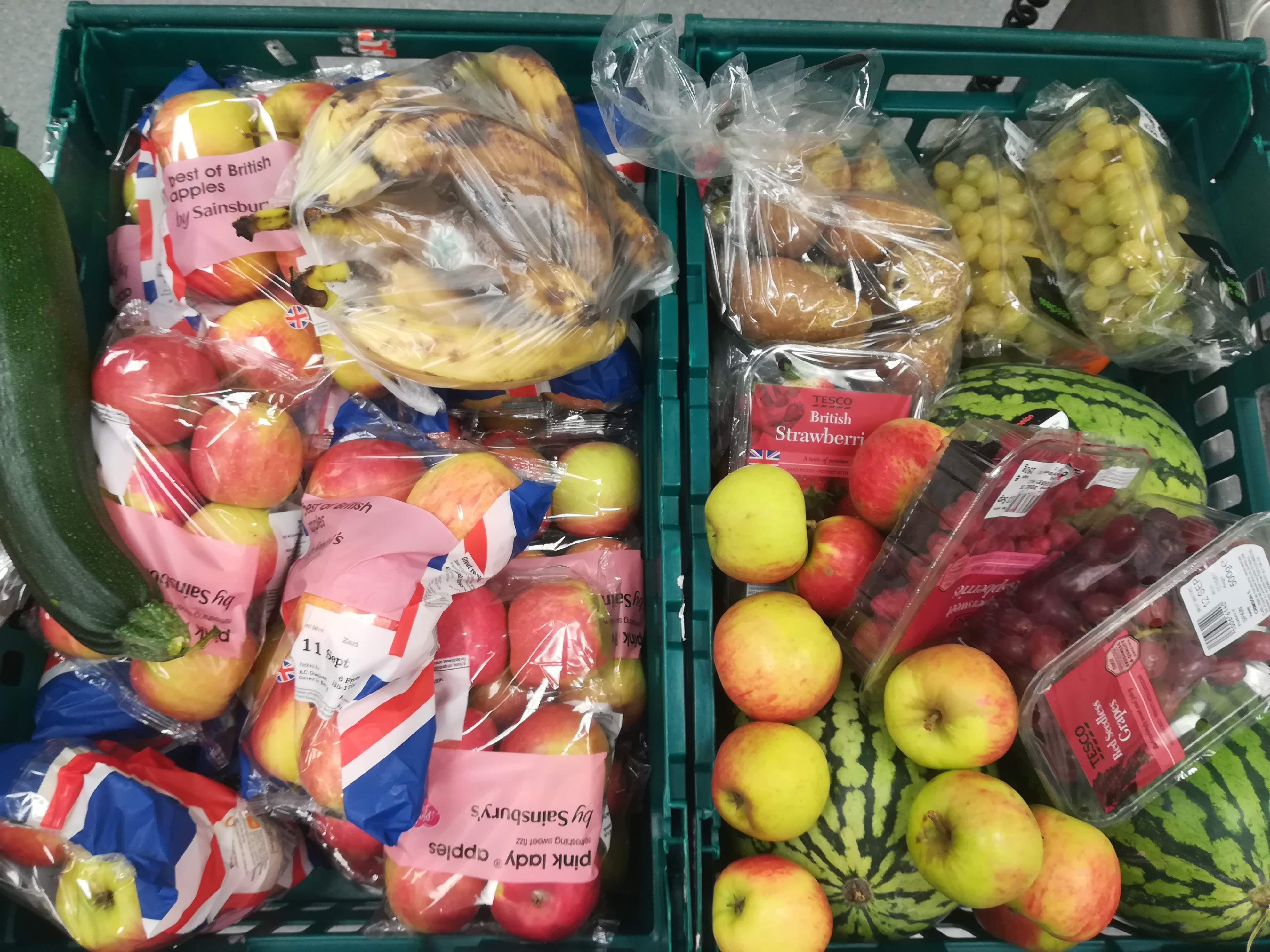 Surplus fruit and vegetables in a supermarket crate