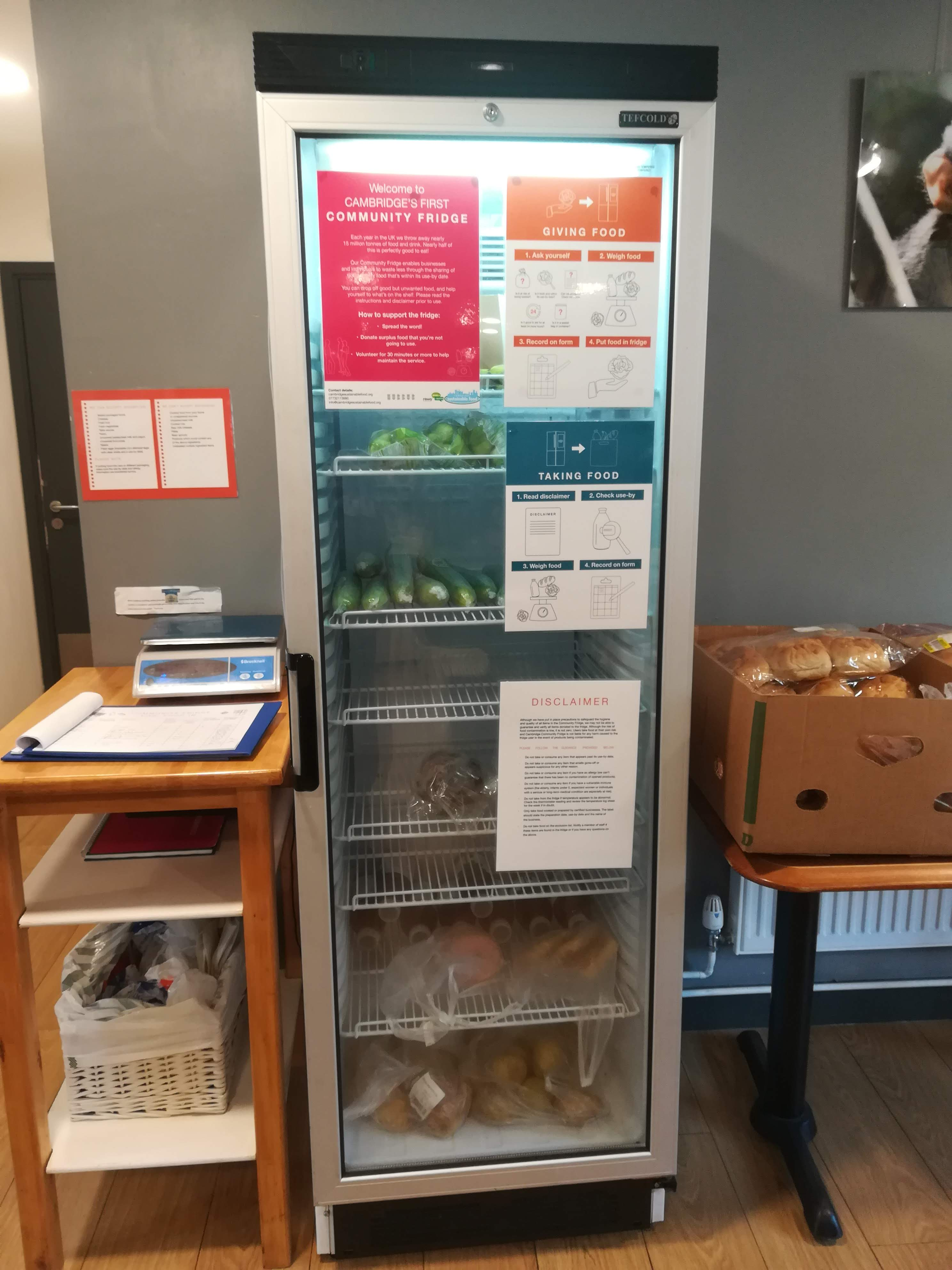 A tall community fridge in a cafe