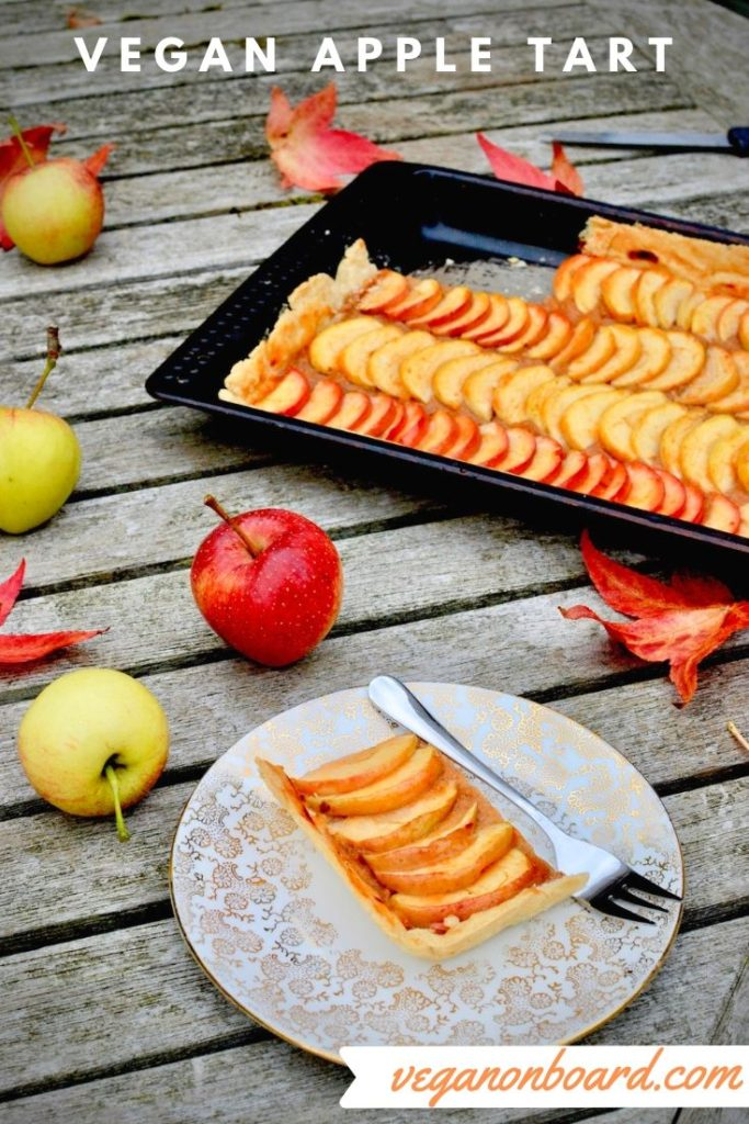Autumnal leaves and apples surround the Vegan Apple Tart
