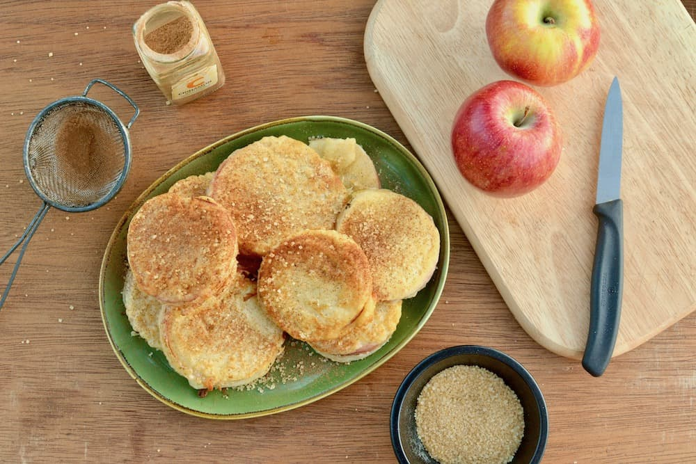 Apple fritters covered in cinnamon sugar