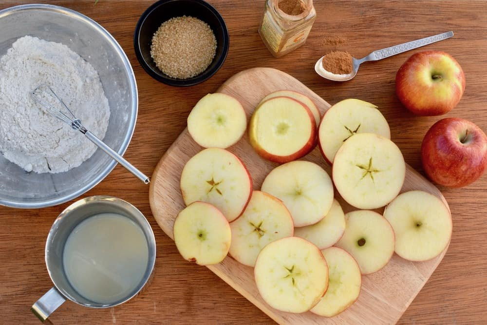Ingredients for vegan apple fritters - flour, soy milk. apple, sugar and cinnamon