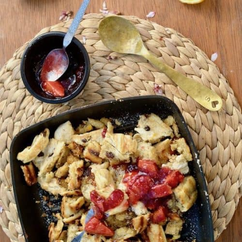 Caramelised pancake pieces covered in red fruit compote