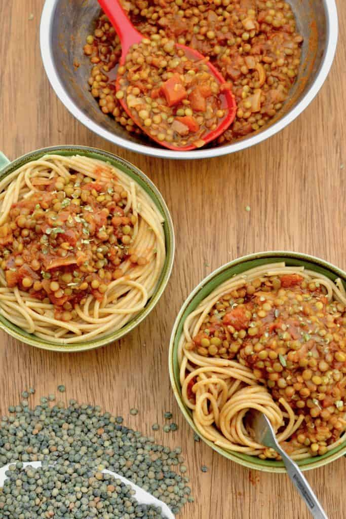 Two bowls of vegan lentil ragu and spaghetti for dinner