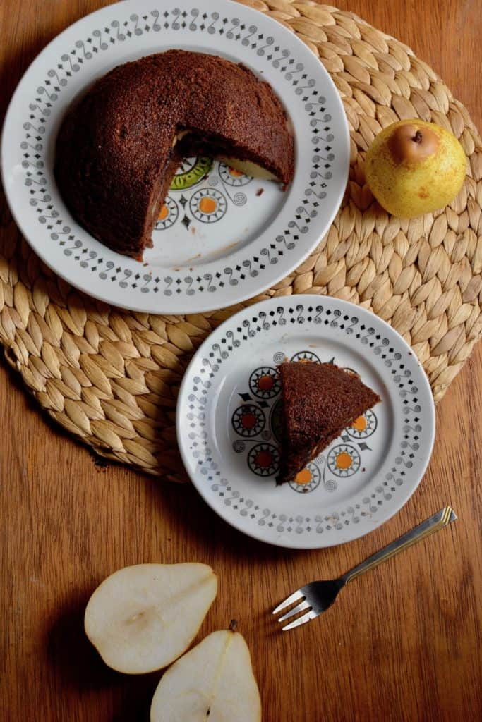A slice of vegan chocolate and pear pressure cooker cake