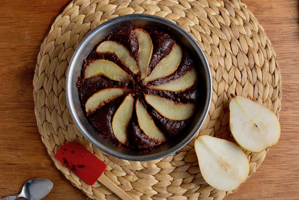 A chocolate cake covered in pears, made in a pressure cooker