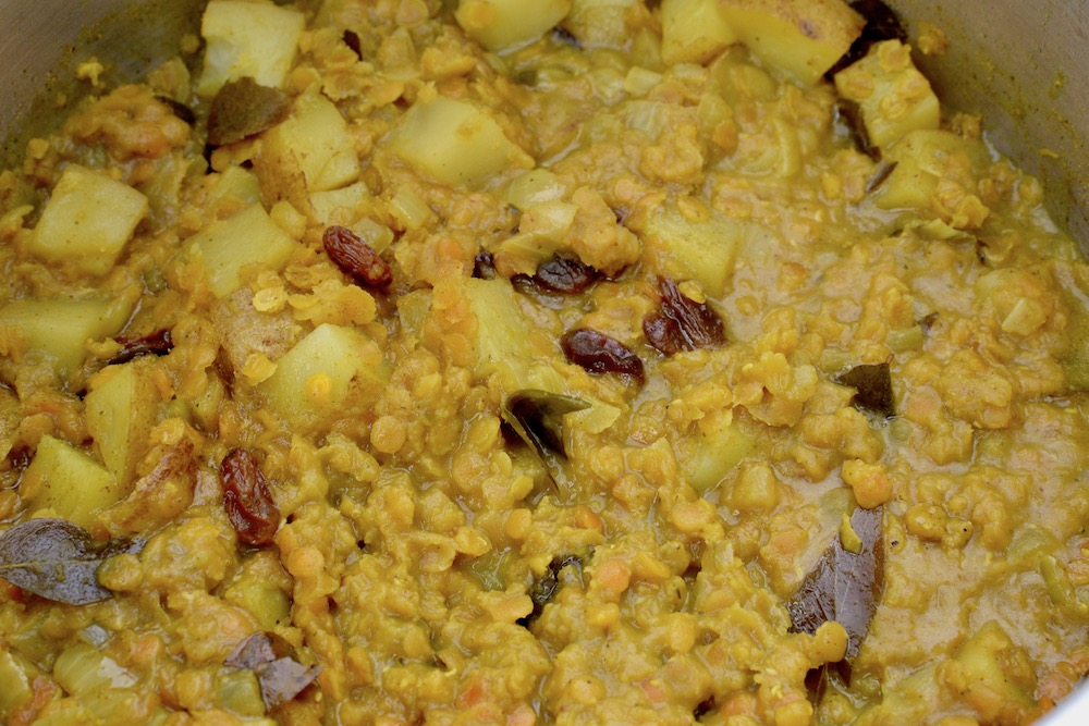 A lentil dal made with potatoes and raisins