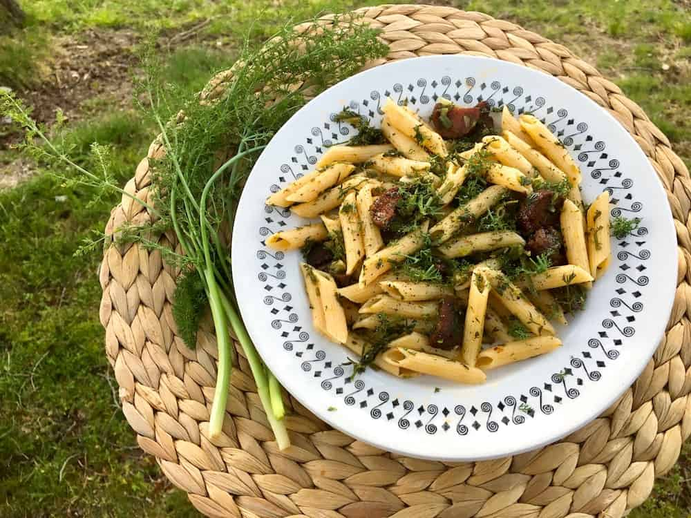 Wild fennel alongside a plate of fennel and vegan chorizo penne pasta