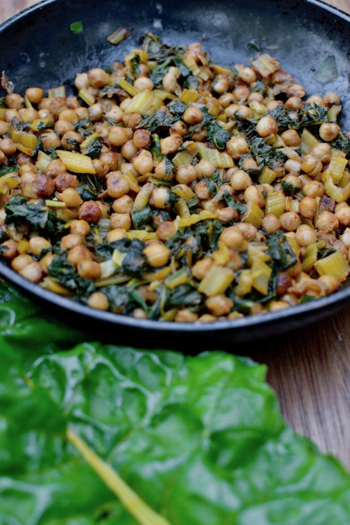 Fried chickpeas and chard ready to eat