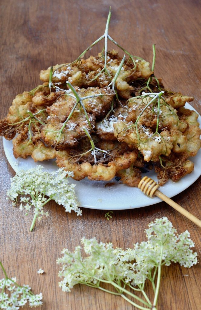 A plate of crispy, fried elderflower blossoms