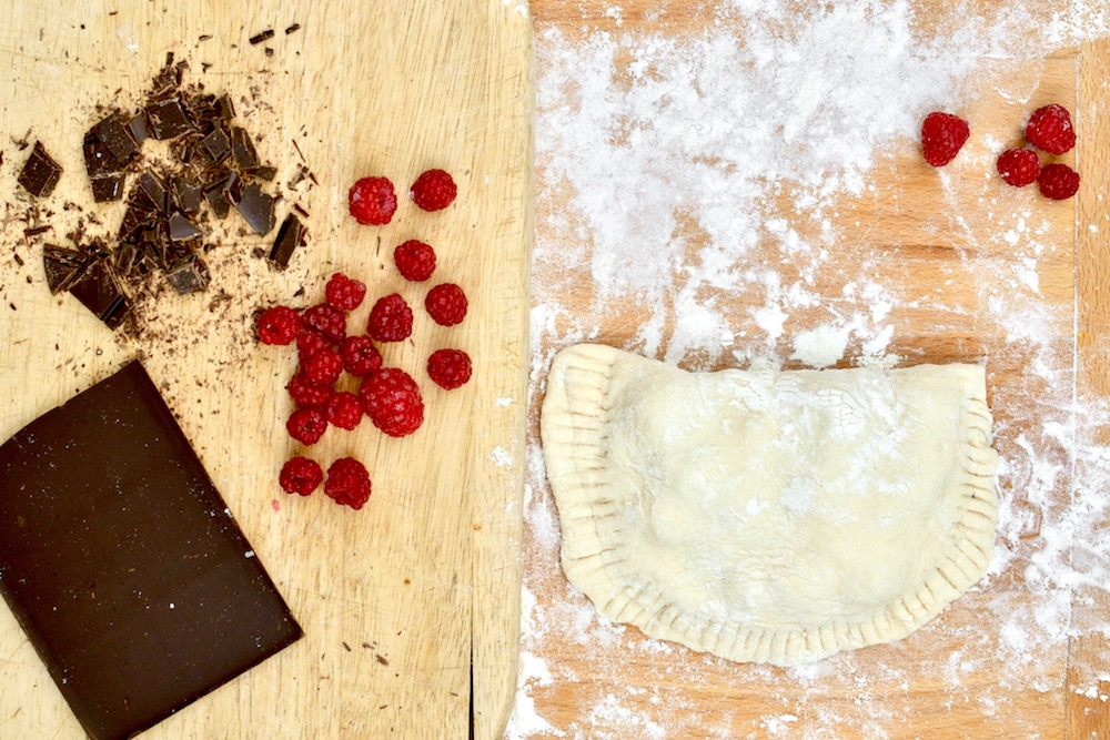 Assembling a chocolate and raspberry dessert calzone