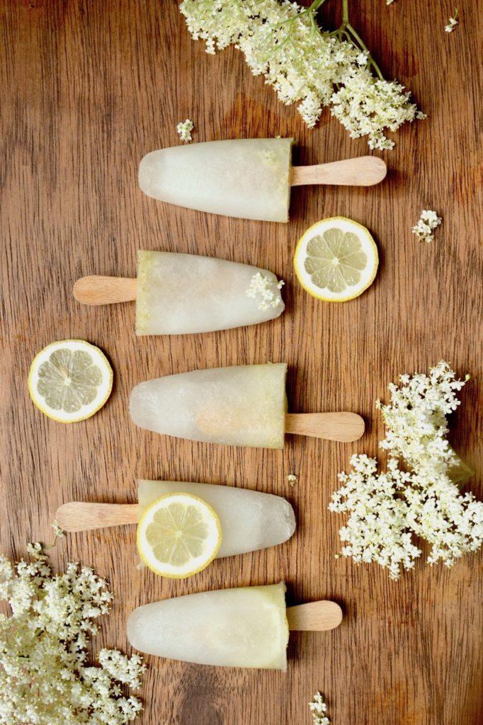 Lemon elderflower lollies arranged in a row