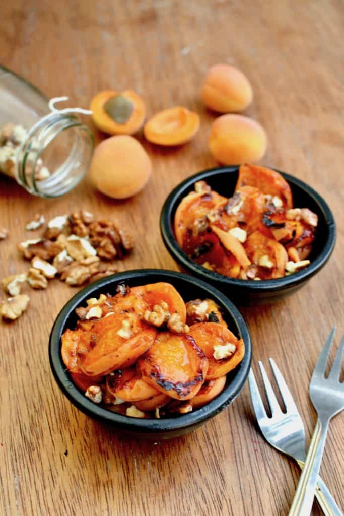 2 servings of deliciously juicy grilled apricots, with almonds spinkled on top