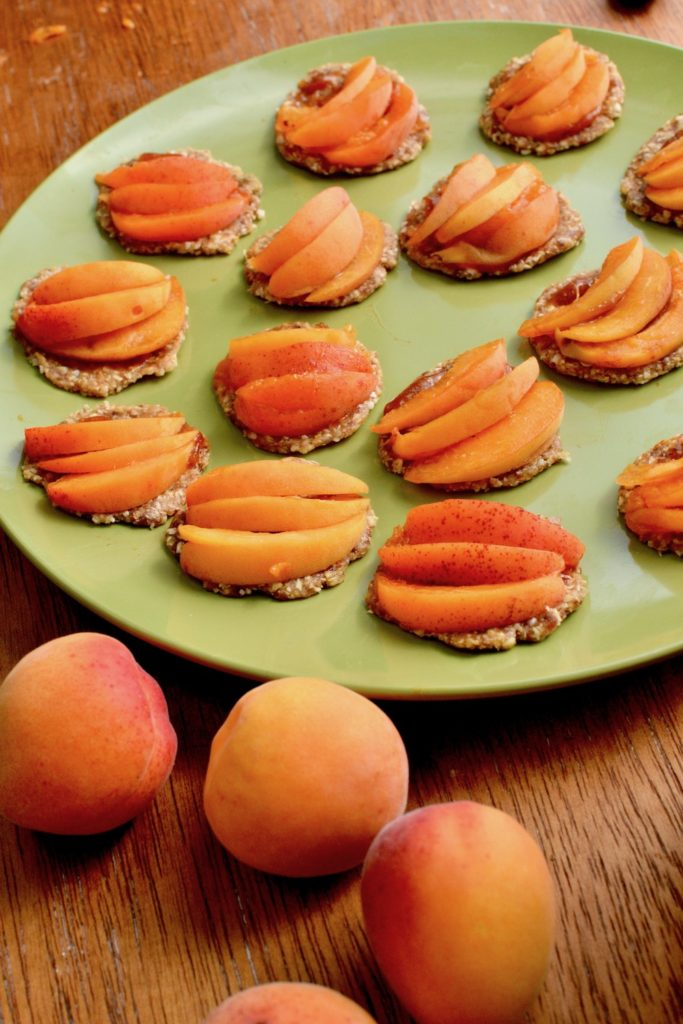 Thin slices of apricot on the mini tarts