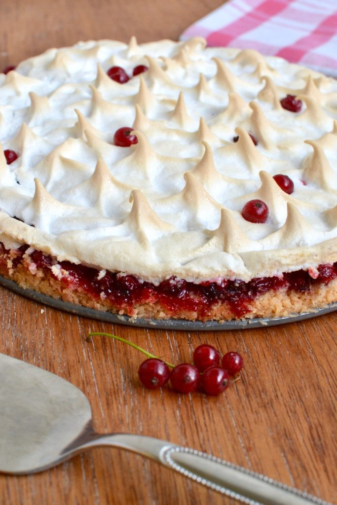 The three layers of the tart - crunchy base, juicy redcurrants, and aquafaba meringue topping.