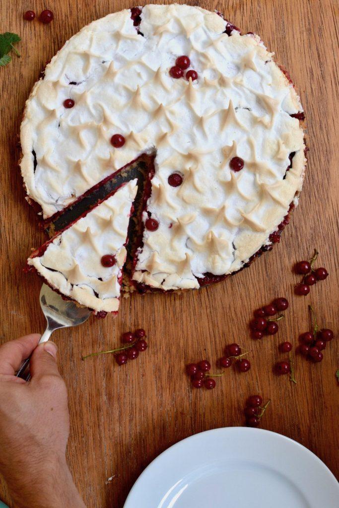 Cutting a piece of the vegan redcurrant tart