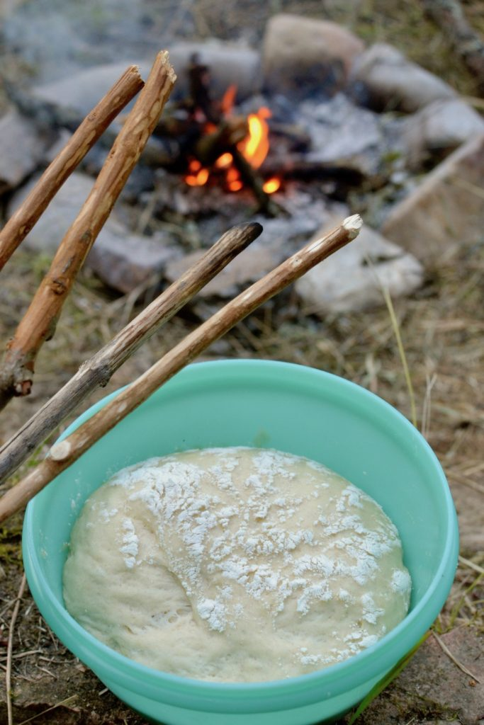 The risen dough by the campfire