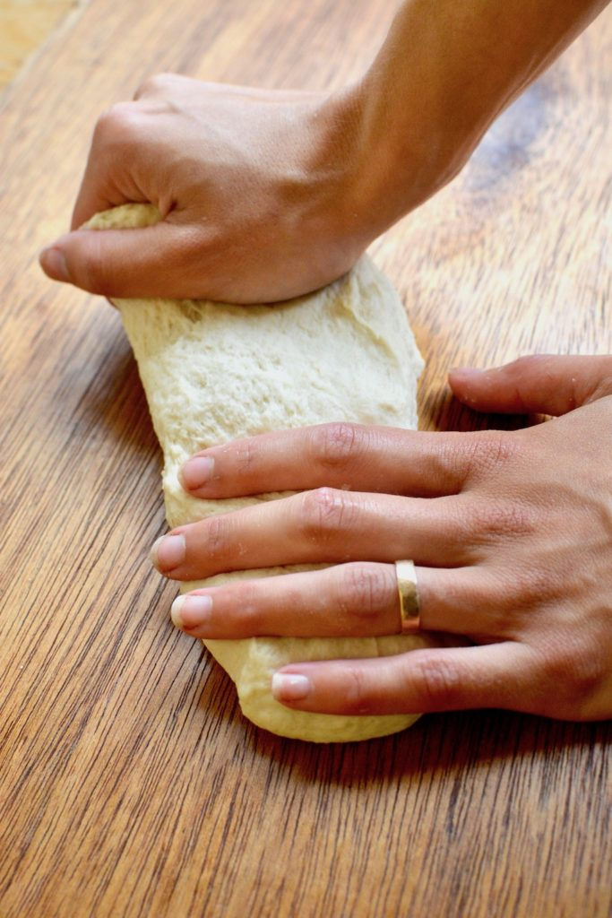 Kneading the dough on a wooden board