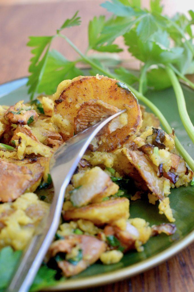 The crispy crust of a potato in a vegan breakfast scramble