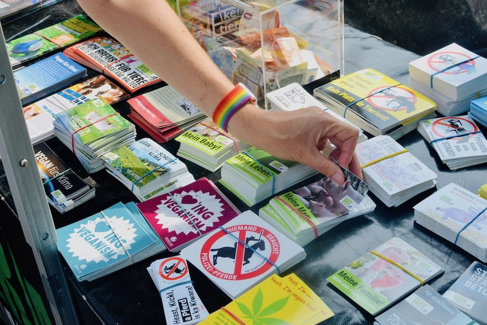 Stickers on a table at the Austrian vegan society stall