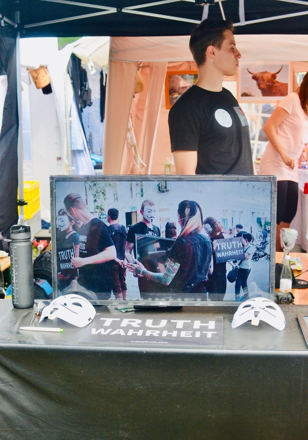 The Anonymous for the Voiceless stall showing footage of the cube of truth