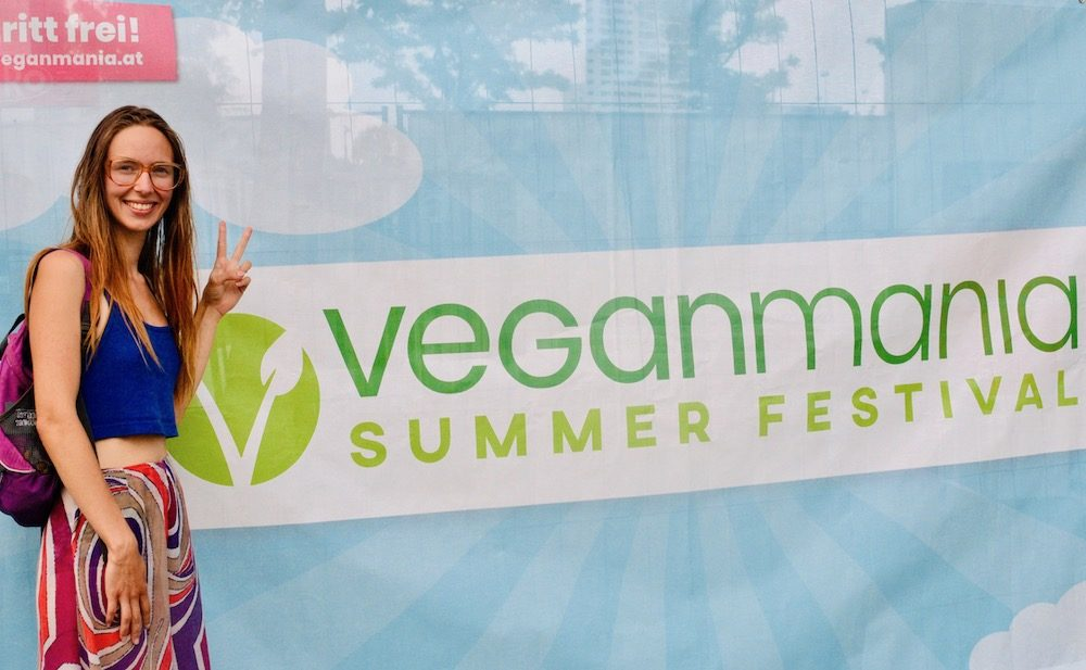 Sophie makes the V sign next to a banner for Vegnamania