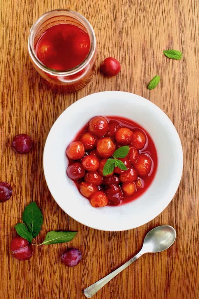 A bowl of red plum compote