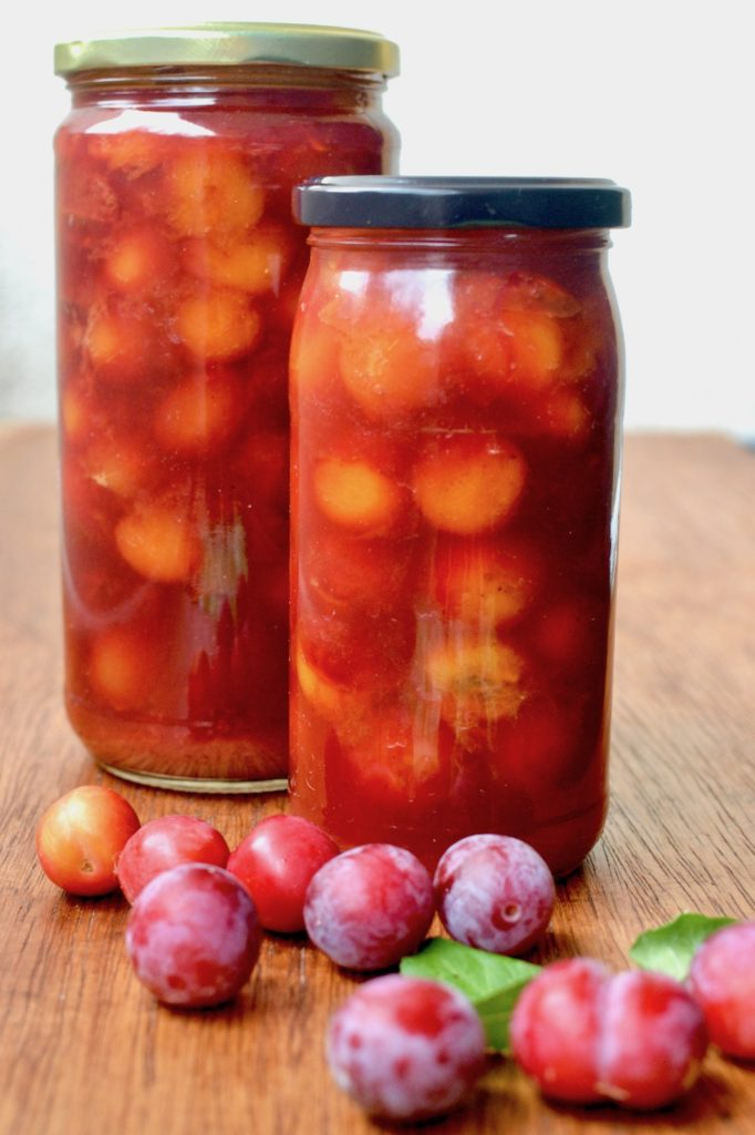 Two jars of fruit compote made with wild plums.