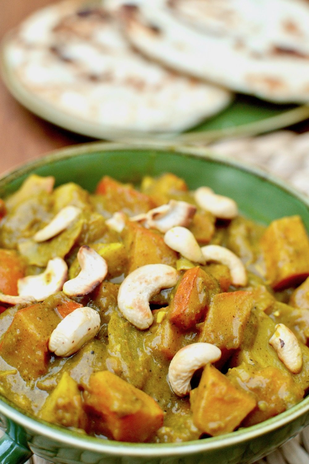 Toasted cashew nuts on top of a pumpkin curry