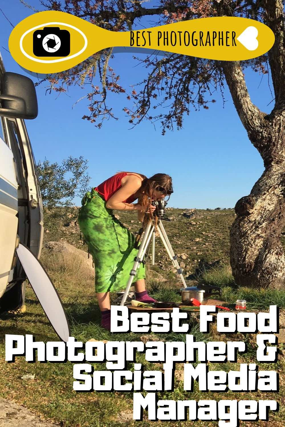 Sophie taking a picture of food nicely plated up on a wooden board outside the open campervan door.