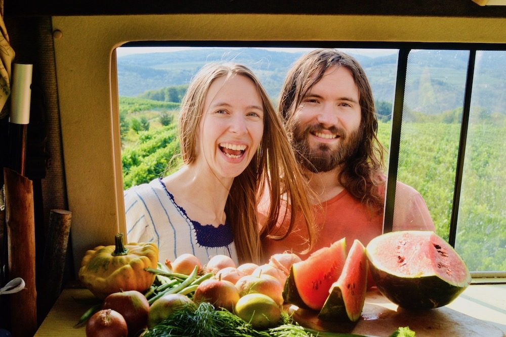Sophie and Paul with fresh produce in the campervan