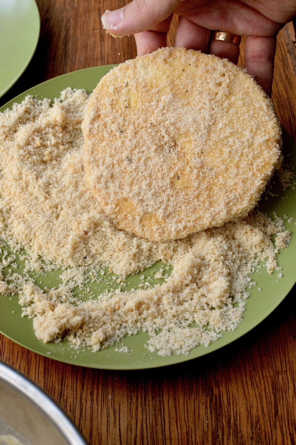 Coating the celeriac slice in fine breadcrumbs