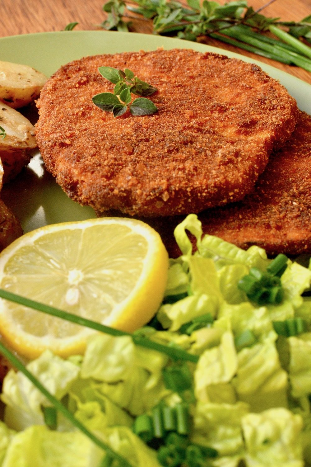 The dark golden brown crust of the freshly cooked vegan schnitzel