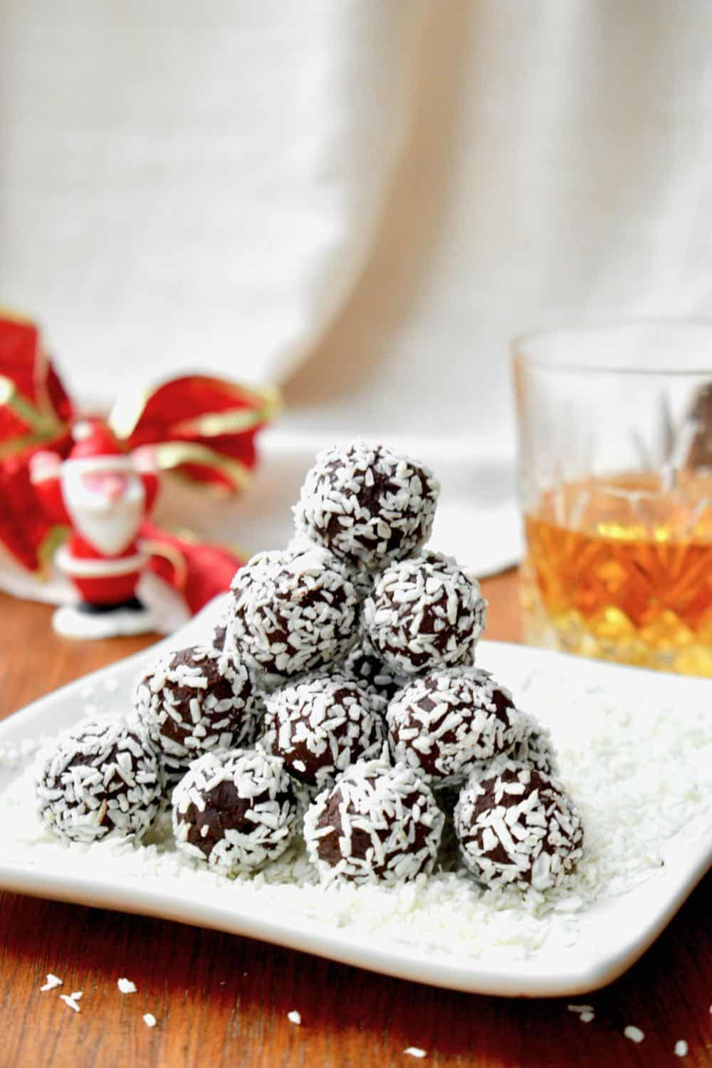 A pyramid of coconut covered rum truffles