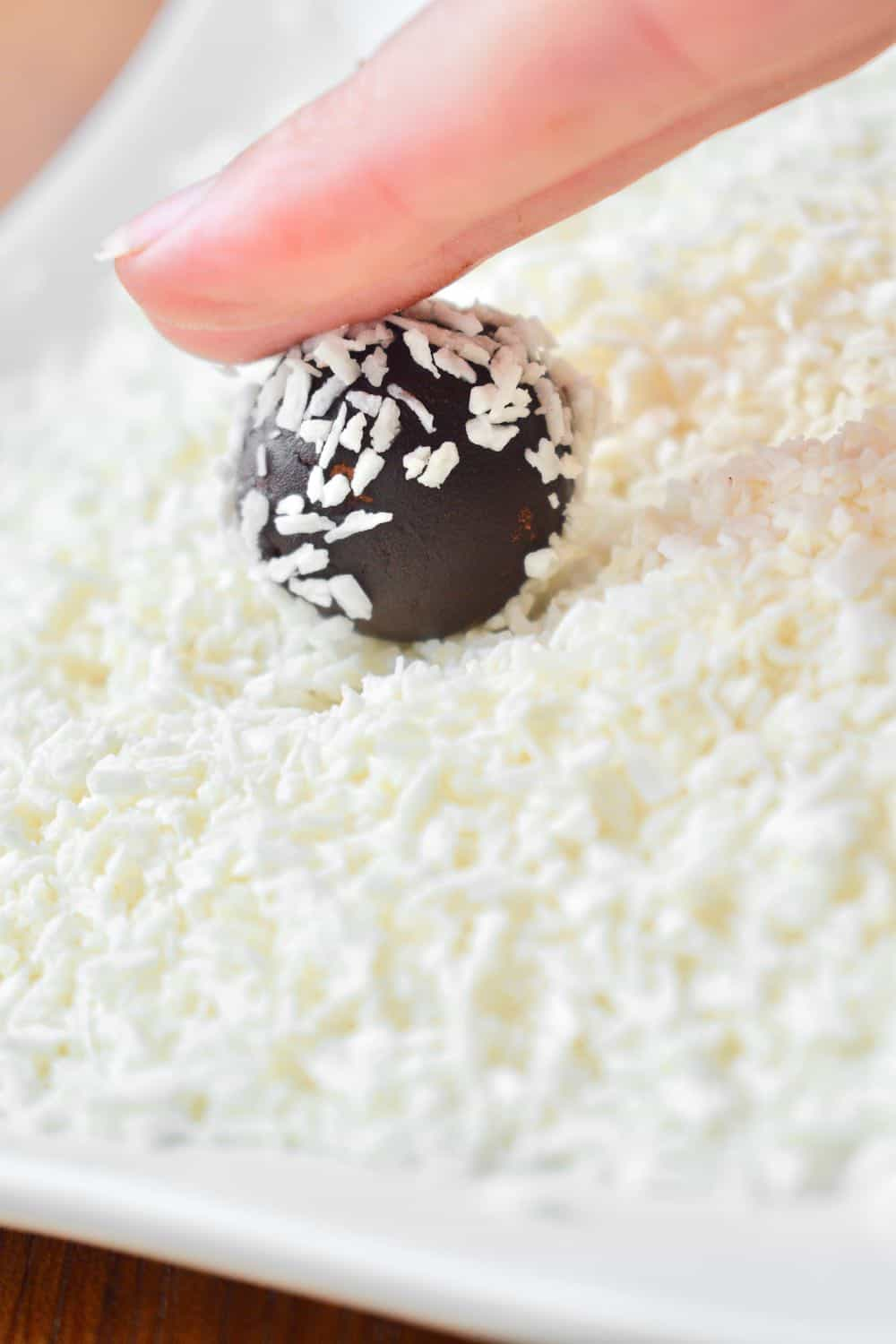 Rolling the rum ball in coconut
