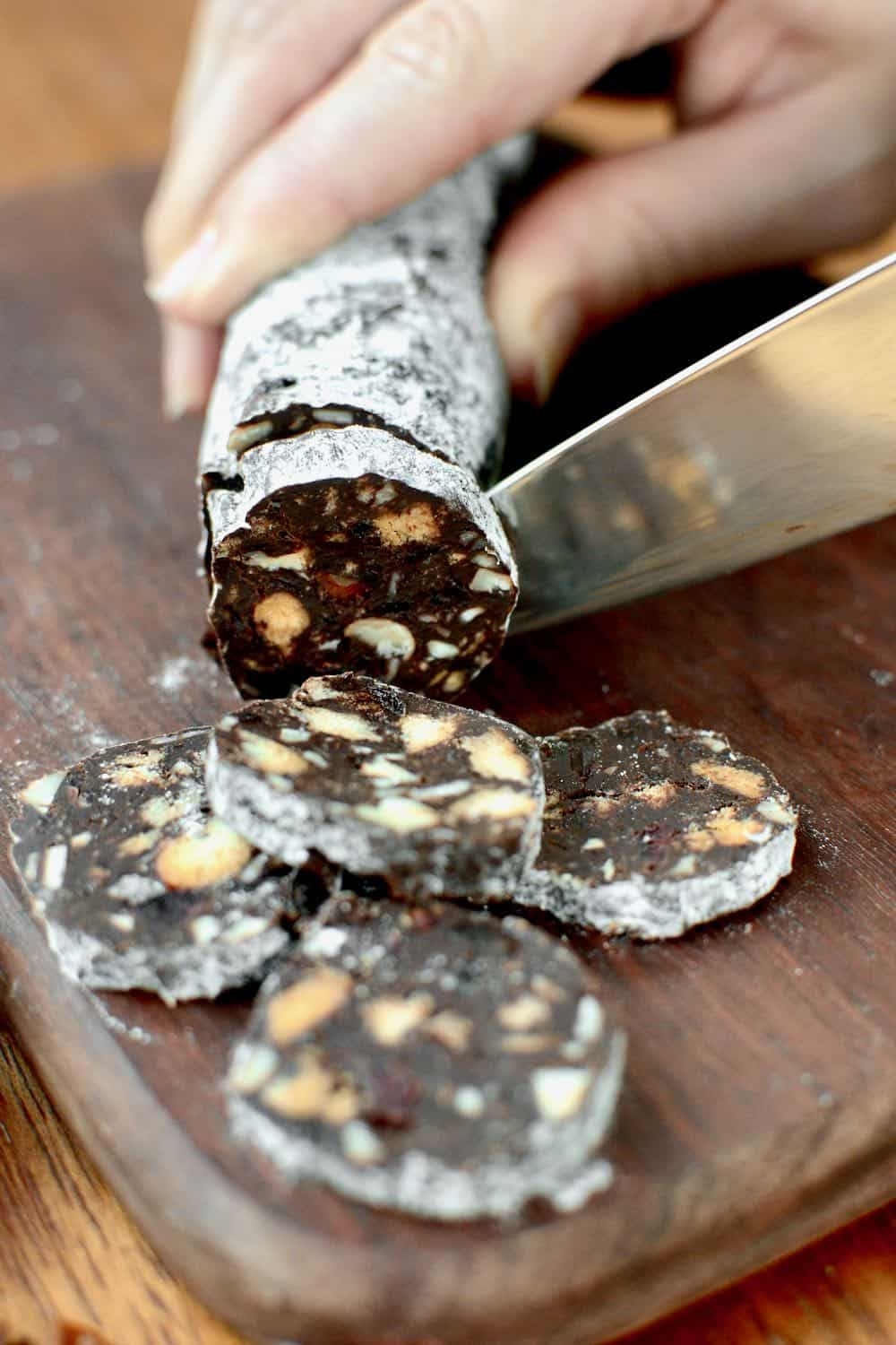Cutting slices of chocolate salami