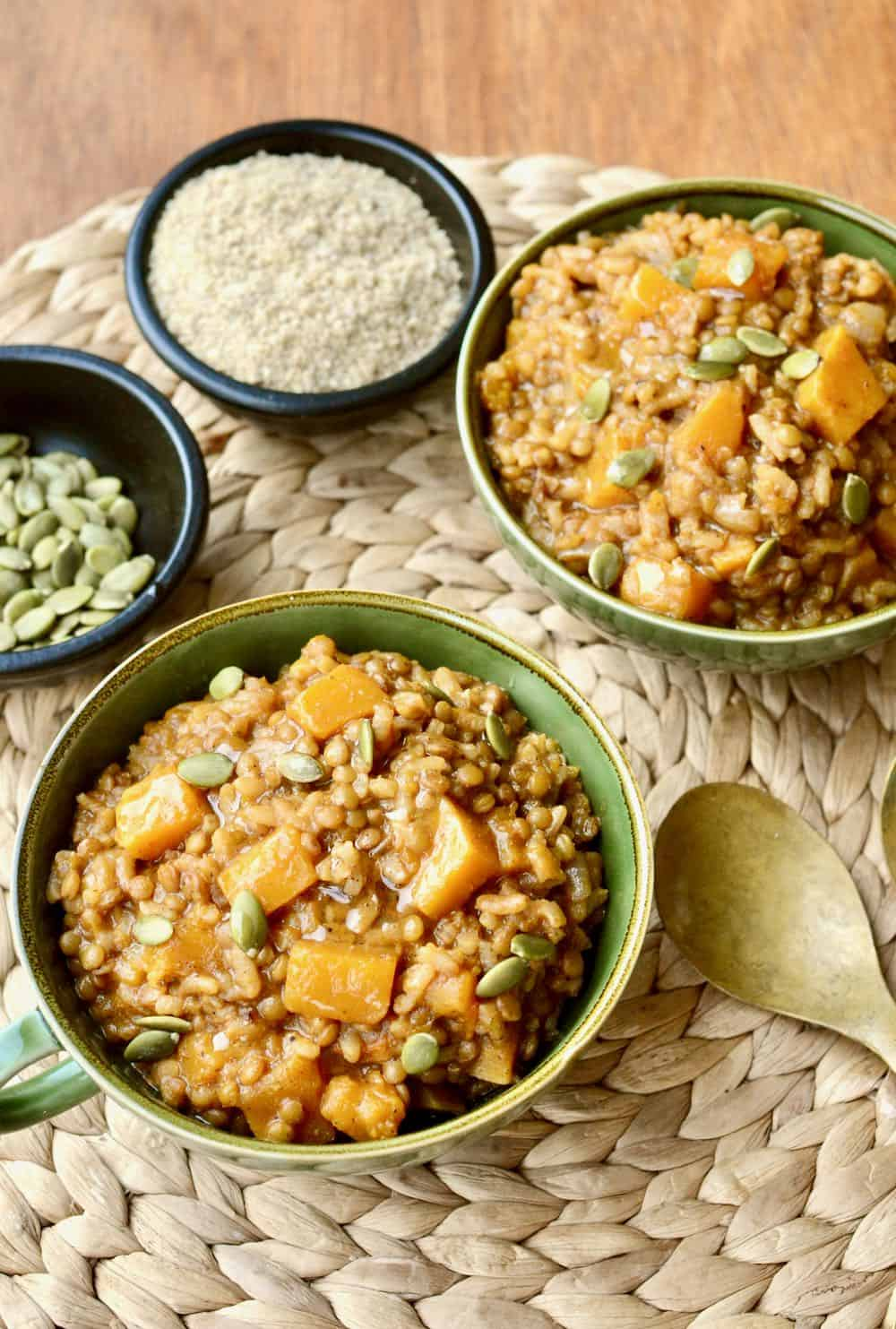 Two bowls filled with a creamy and earthy looking risotto