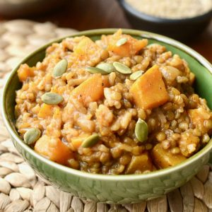 Creamy risotto with chunks of butternut squash and topped with pumpkin seeds