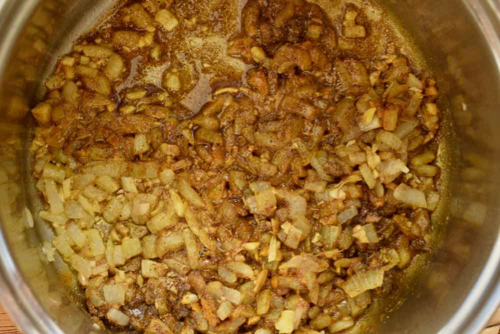 The golden tone of onion, garlic, ginger and spices frying