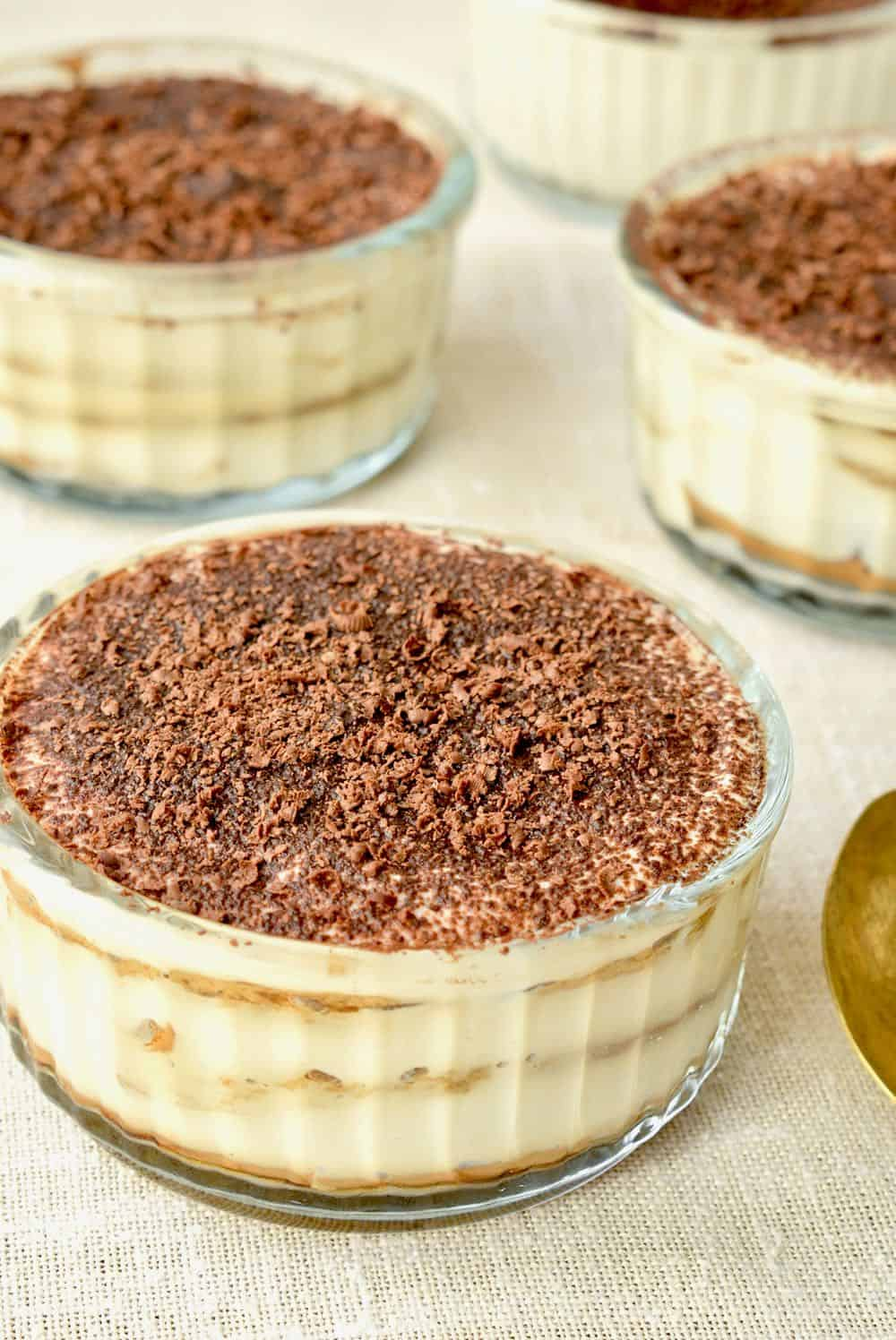 Individual servings of vegan tiramisu with chocolate and cocoa on top