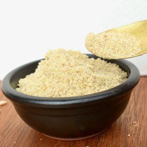 A small dish of vegan parmesan cheese