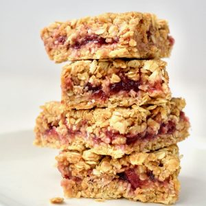 A stack of four squares of PBJ oat bars