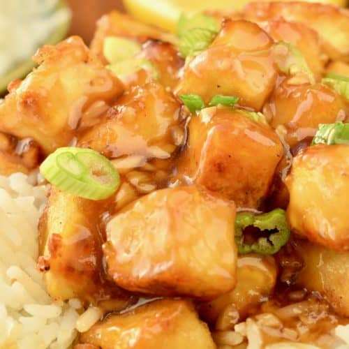 Cubes of tofu coated in a sticky lemon sauce