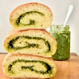Three chunks of fluffy, pesto filled bread stacked on top of eachother