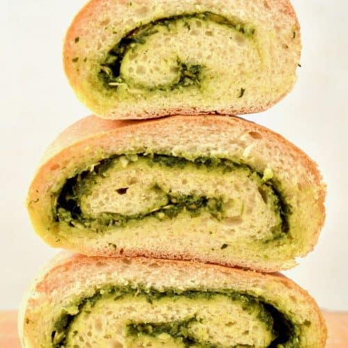 Three piece of bread containing a swirl of pesto inside
