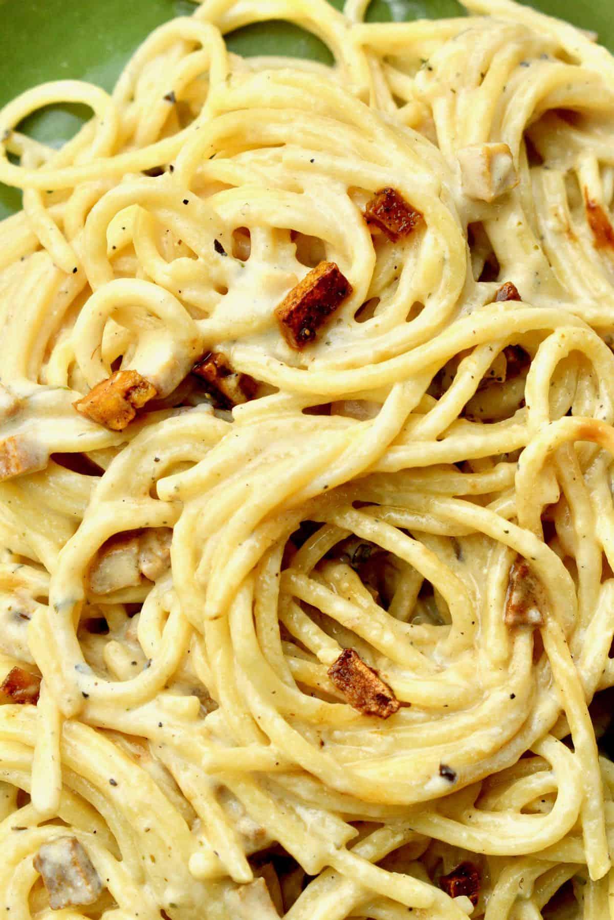 Spaghetti covered in a creamy carbonara sauce