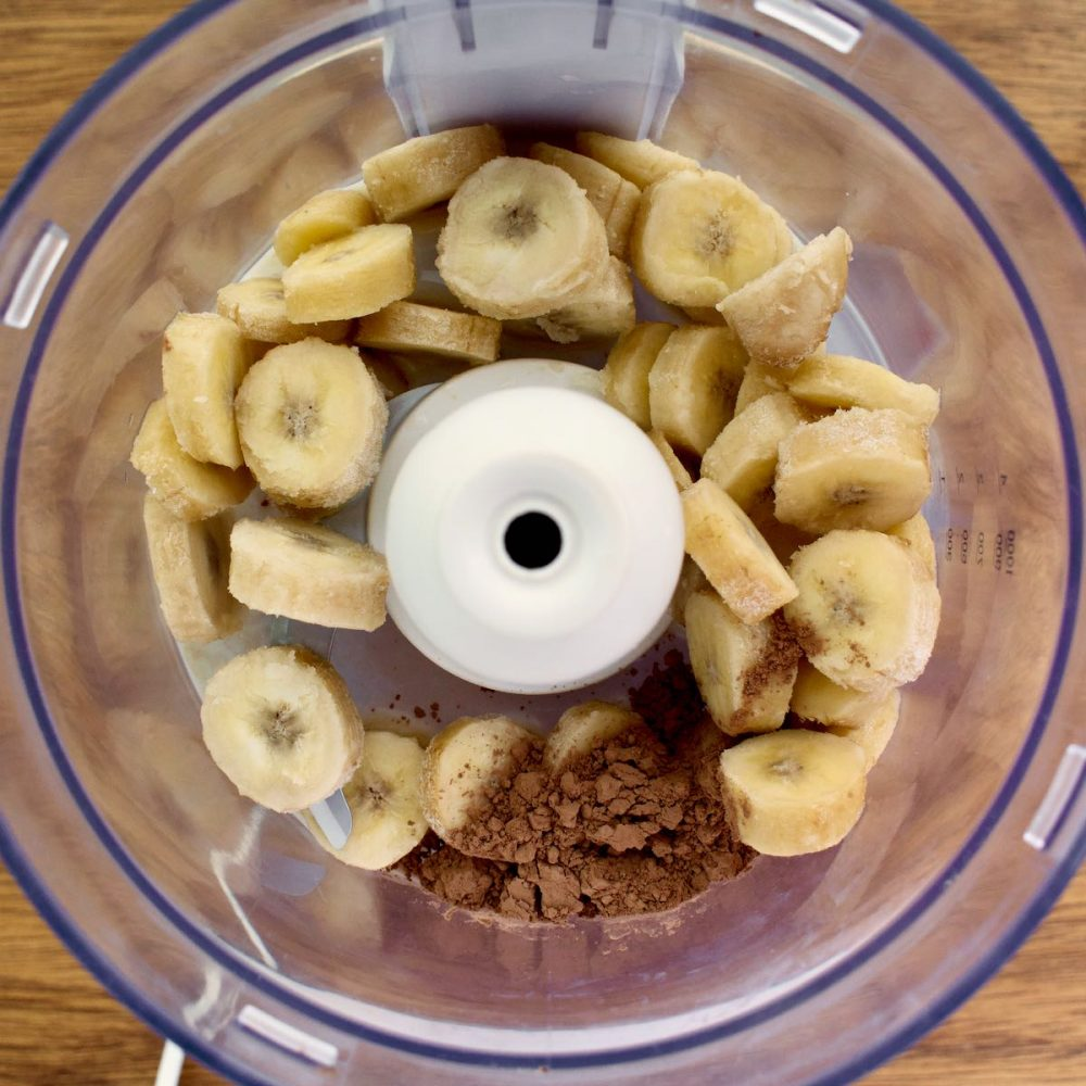 Banana slices, cocoa powder and soy milk in a blender