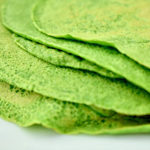 A stack of thin green spinach pancakes