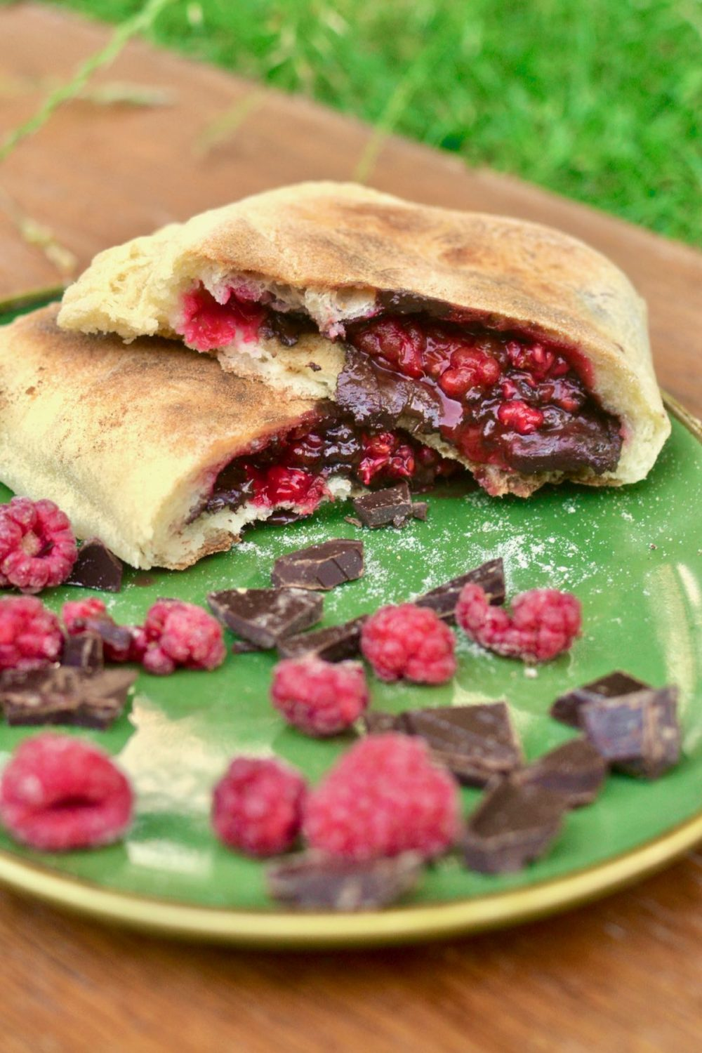 A cooked calzone showing its filling of raspberries and now melted chocolate.