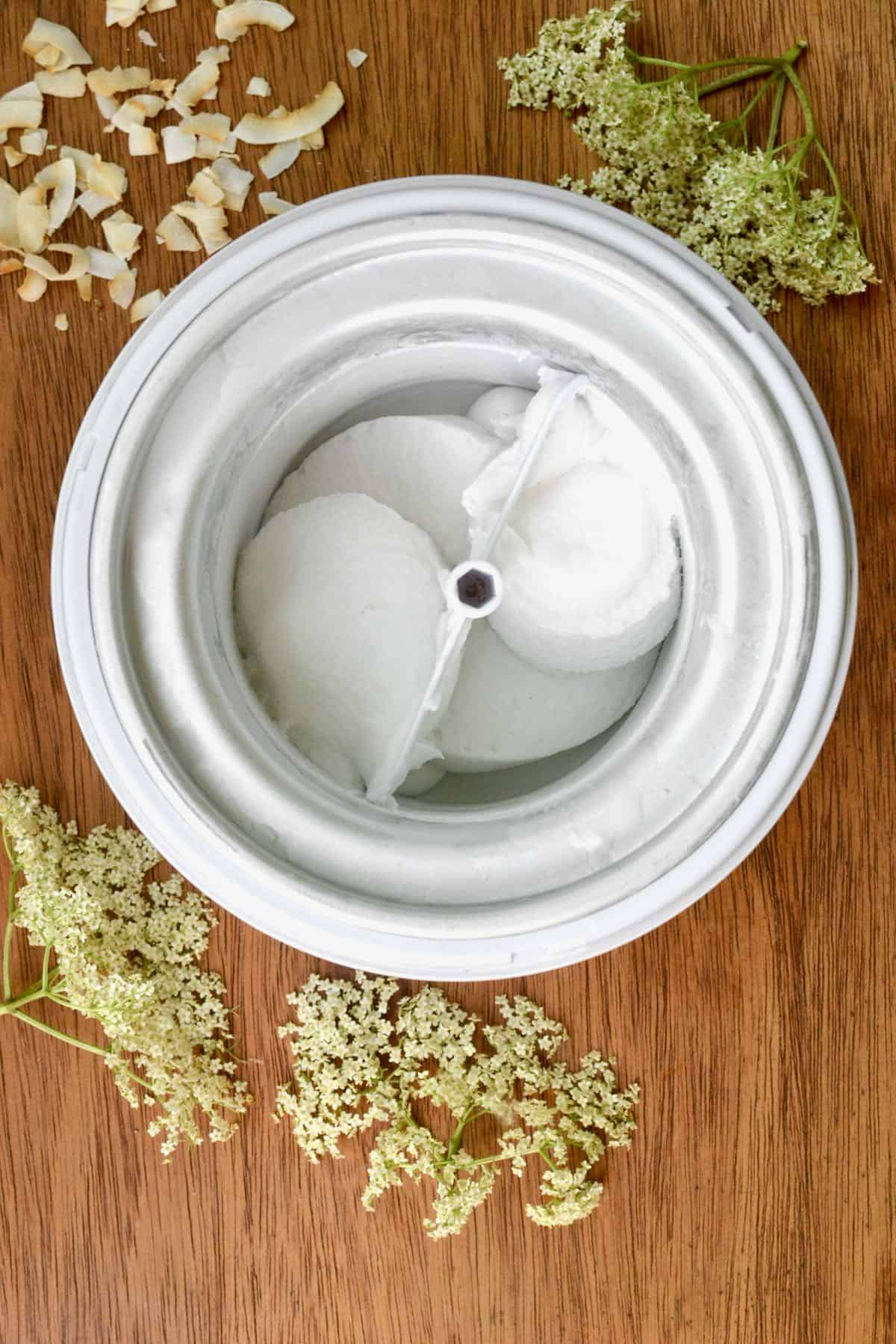 A top down view of the ice cream maker shows the freshly churned white ice cream.