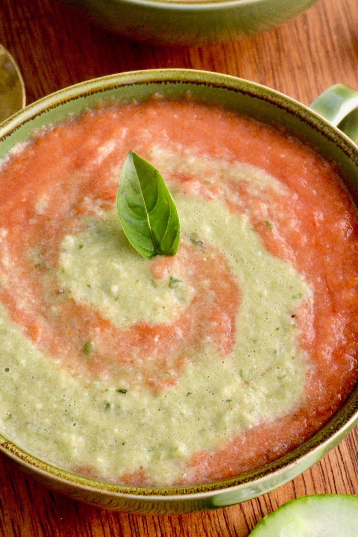 A basil leaf garnishes the gazpacho